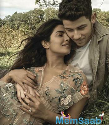 Nick Jonas' grand birthday celebrations weren't over just yet and now, a picture of Priyanka Chopra and Nick Jonas posing next to a gigantic bottle shaped birthday cake has surfaced online.