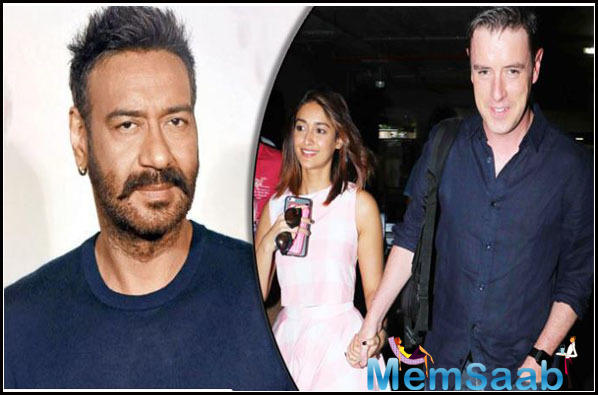 Ajay Devgn is helping Ileana D'Cruz to cope-up with her break up with boyfriend Andrew Kneebone?