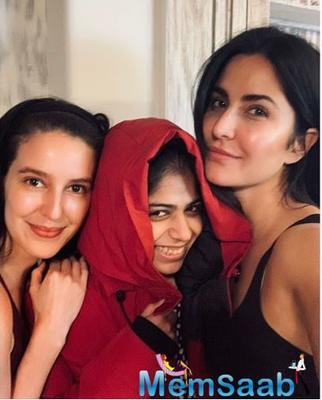 Katrina Kaif poses for a happy picture with sister Isabelle and a friend