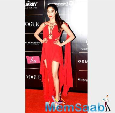 Janhvi Kapoor looked no less than a goddess in a red plunging neckline gown she opted to attend the award ceremony.
