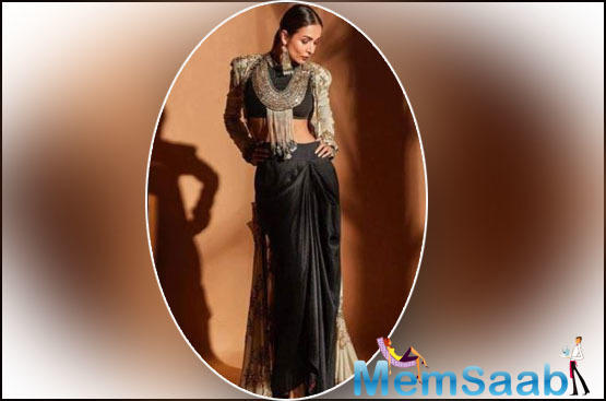 In the alluring pictures, Malla is seen wearing an all-black ethnic ensemble teamed up with a jacket which she accessorised with a heavy silver neckpiece and a pair of long silver earrings.
