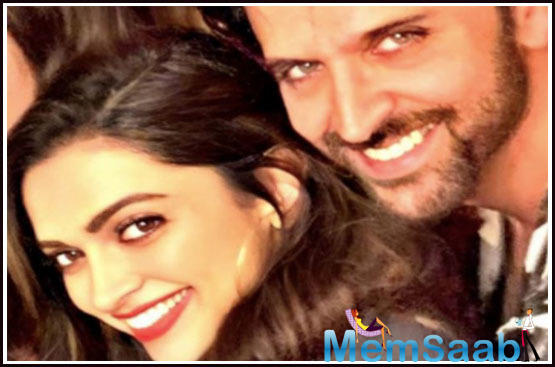 Hrithik Roshan and Deepika Padukone pose together at a party and we cannot wait to see them in a film!