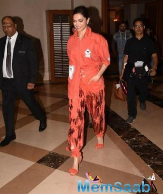 Deepika Padukone's all orange outfit on the eve of birthday celebrations screams bold and chic