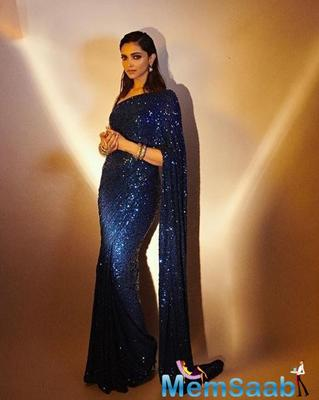 Even yesterday, she shined in a blue sequined saree by Sabyasachi. Her slicked back hairstyle with a side partition, deep kohl-eyed, and filled-in brows complemented the look.