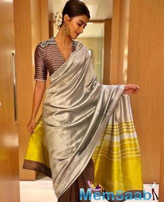Pooja Hegde wore a Payal Khandwala's triple coloured handwoven silk saree from the Mira collection.
