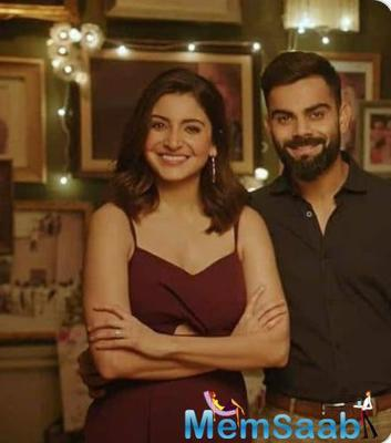 While in one picture, Anushka and Virat are seen holding drinks in their hands while Virat lovingly kisses Anushka on her forehead, in another one, they are seen striking a pose for the camera.