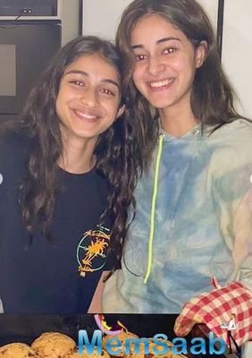 Ananya Panday shared a series of pictures with her sister Rysa, who is seen holding a tray full of freshly baked cookies.