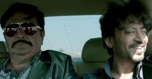 The photo shows Rishi and Irrfan sitting in a car in a still from the film