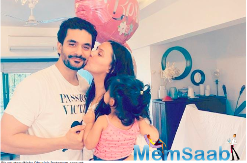 Neha Dhupia and Angad Bedi marked their second wedding anniversary on Sunday by cake-cutting at home.