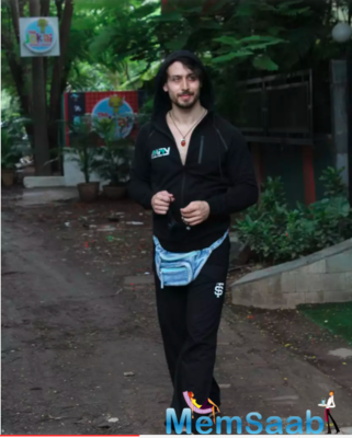Tiger Shroff poses for the paparazzi as he steps out of a dubbing studio in Mumbai