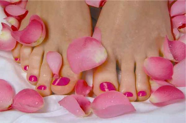 feet and flower petals