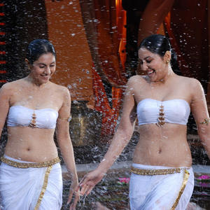 Divya Parameshwaran And Pooja Chopra Cool And Sexy Look Still From Rajakota Rahasyam Movie