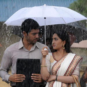 Ashwin And Srushti In Rain Photo Still From Tamil Movie Megha