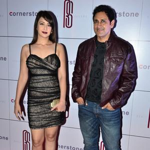 Preeti Jhangiani And Hubby Parvin Dabas Nice Glamour Pose During Rohit Sharma Bash