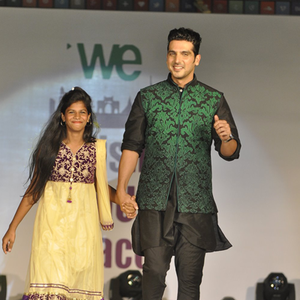 Zayed Khan On Ramp With A Kid At The Global Peace Initiative 2014