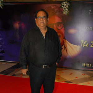 Satish Kaushik Posed For Camera On Red Carpet At The 2nd Yash Chopra Memorial Award