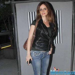 Sussanne Khan Went For A More Grunge Look In A Tee Shirt, Leather Vest And Denims