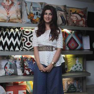 Twinkle Khanna Was Effortlessly Chic In A White Belted Blouse With Blue Culottes And Peep Toes