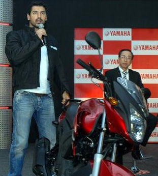 John Abraham with CEO and M.D. Yukimine Tsuji at a press conference in Greater Noida