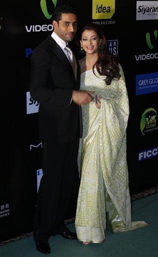 Abhishek Bachchan and aishwarya bachchan poses to photo shoot