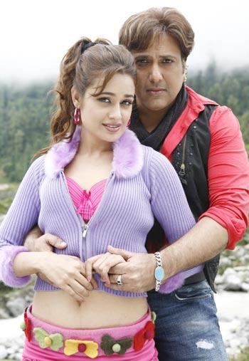 Govinda and Yuvika Chaudhary in Naughty