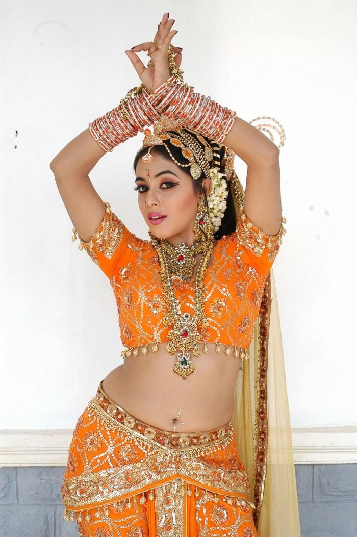 Actress poorna snake dance still