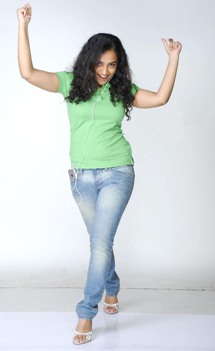 Nithya Menon cute pose with green tops and tight jeans