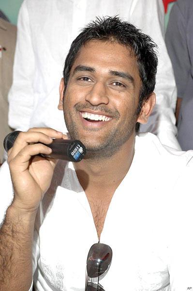 Mahendra singh dhoni with open smile pics