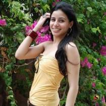 Sonia Mehra sleeveless dress cute smile pic