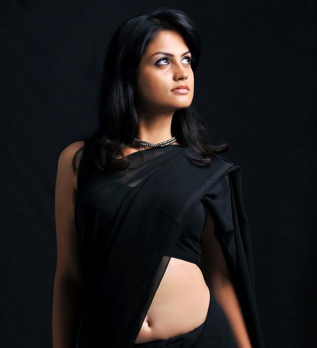 Madhulika hot navel still in black color saree