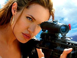 Angelina Jolie space photos in gun