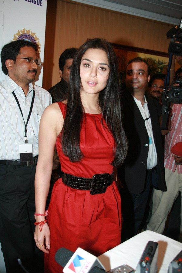 Preity Zinta red dress press meet still