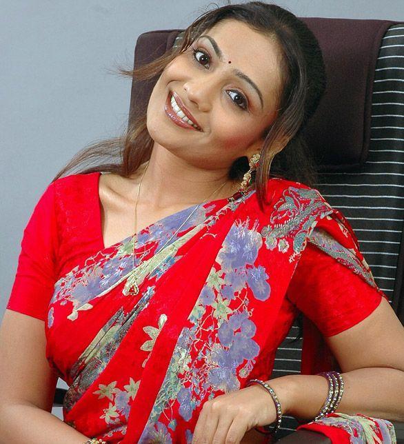 Meera Vasudevan red saree cute still