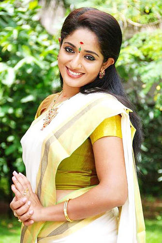 Kavya Madhavan in traditional saree cute still