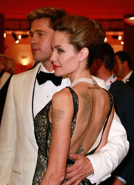 Brad Pitt and Angelina backless dress still