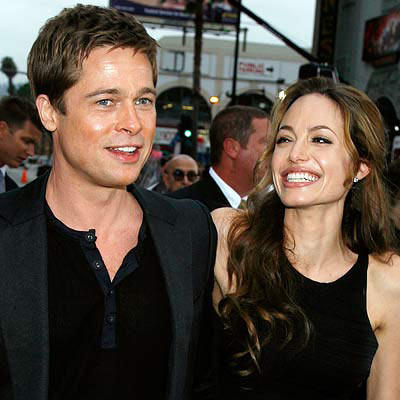 Brad pitt and angelin jolie smilling face look