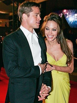 Brad Pitt and Angelina sleeveless dress still
