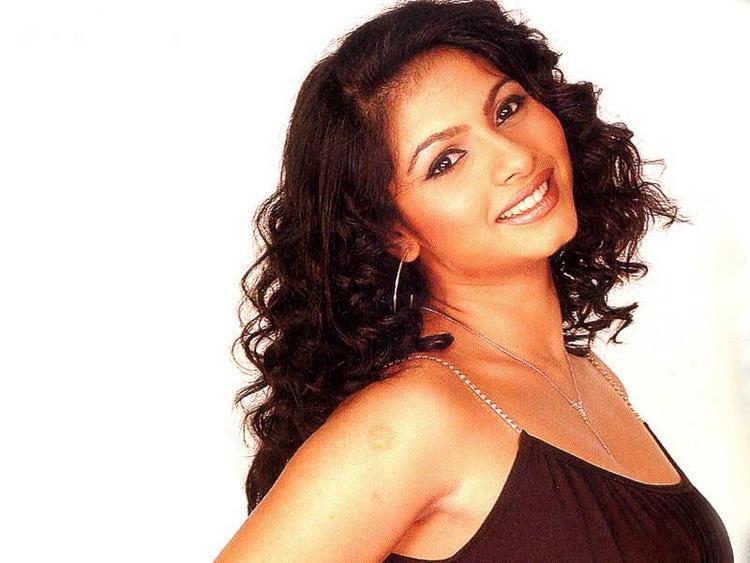 Tanisha Mukherjee curly hair glamour still