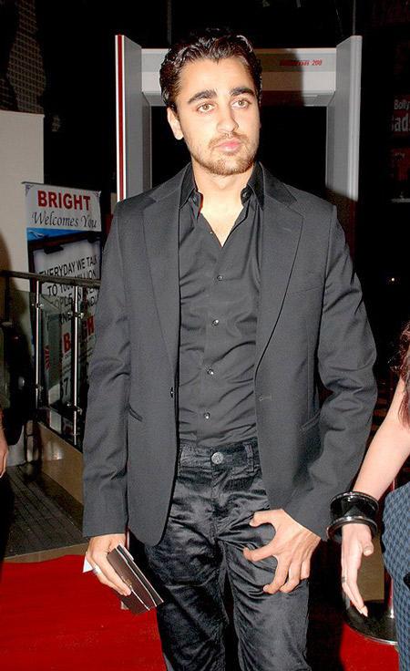 Imran Khan black pent and coat glorious still