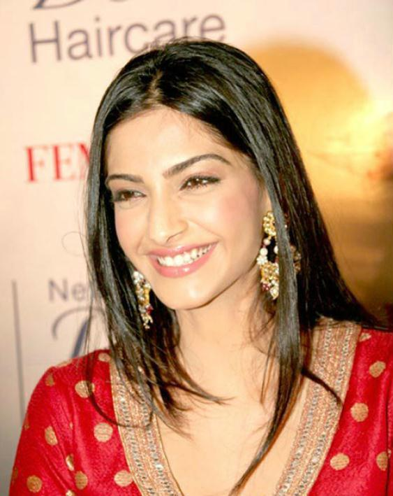 Sonam Kapoor sweet smile with red dress