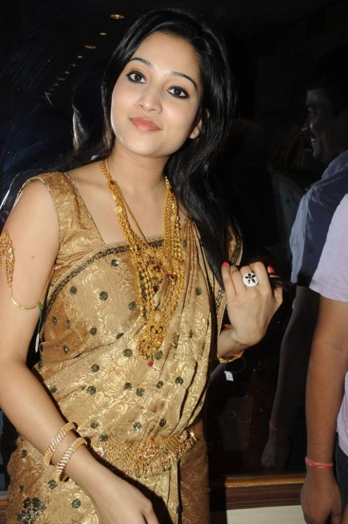 Ritu Barmecha gold color saree photo