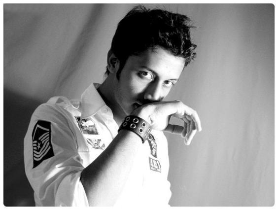 Atif Aslam white shirt hot stylist look