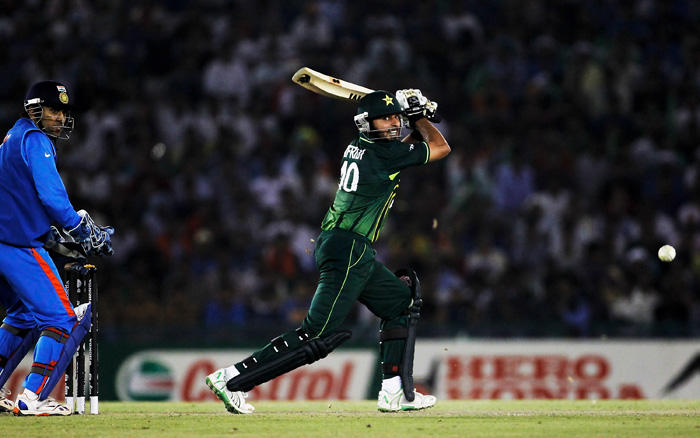 Shahid Afridi play a ball photo in world cup semi final match india vs pakistan