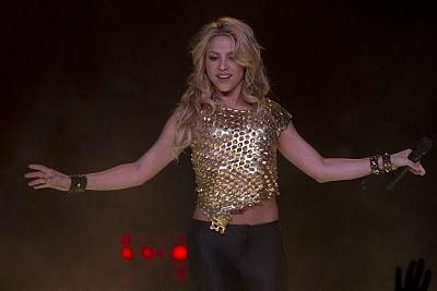 Shakira Perform with top gold color dress