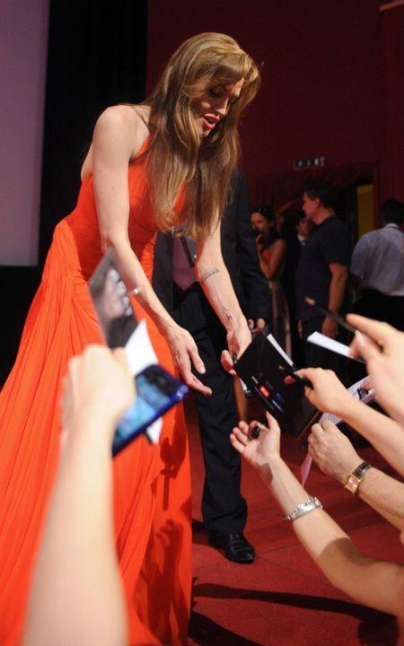 Angelina Jolie orange color gown public photo