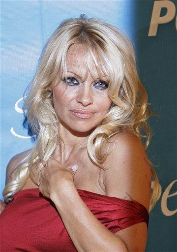Pamela Anderson red dress with white hair photo