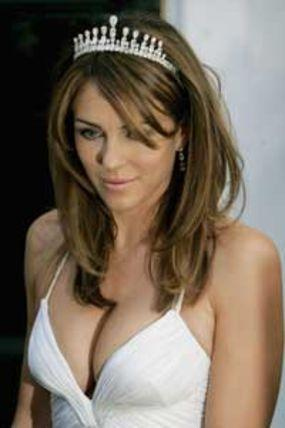 Elizabeth Hurley  open boob show with white dress