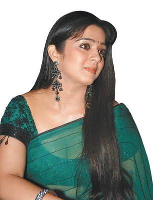 Beautiful Actress Charmi green transparent saree pic