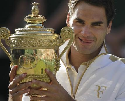 Roger Federer Holds The Trophy After Beating Andy Roddick In The Men's Final