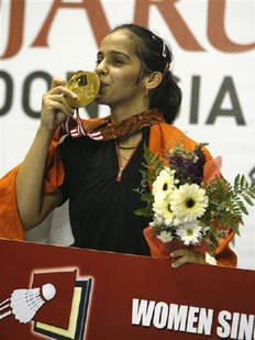 Saina Nehwal Kisses A Medal After Winning The Women's Singles Final